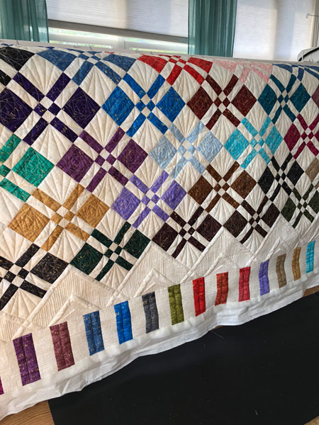 Disappearing Four Patch quilted by Beth Sellers of Cooking Up Quilts