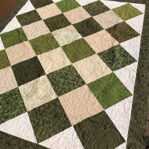On point layer cake quilt quilted by Beth Sellers of Cooking Up Quilts