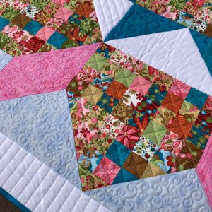 Baby star quilt quilted by Beth Sellers of Cooking Up Quilts