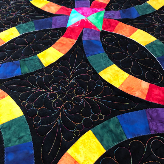 Double Wedding Ring quilted by Beth Sellers of Cooking Up Quilts
