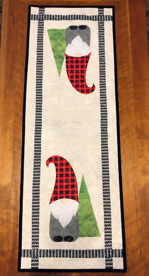 Gnome tablerunner made and quilted by Beth Sellers of Cooking Up Quilts