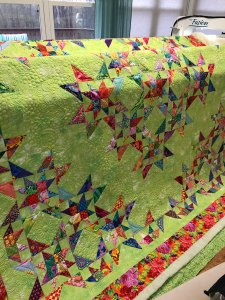 Free Motion quilting on a Kaffe Fassett and Grunge quilt