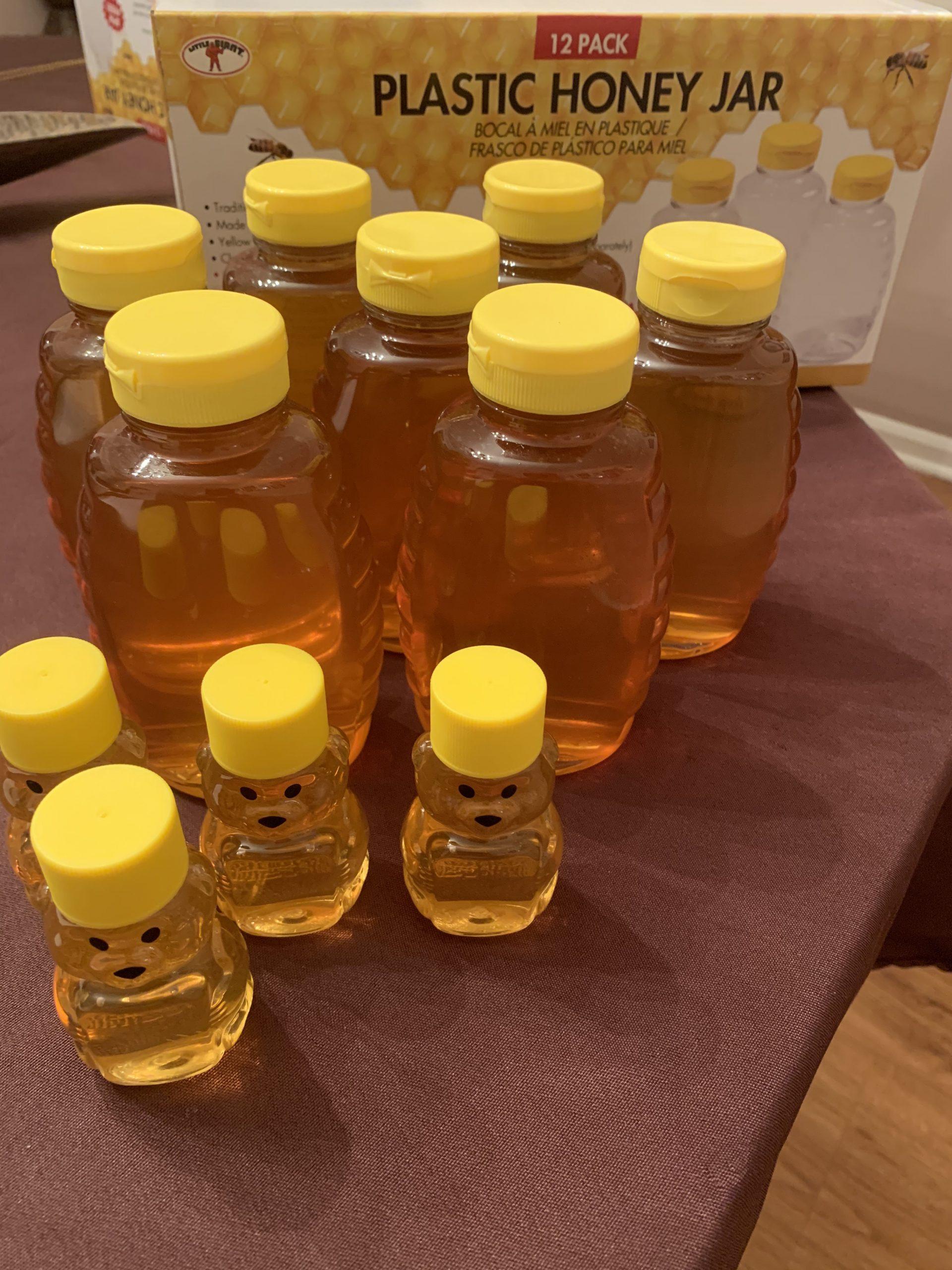Honey bottles on a table