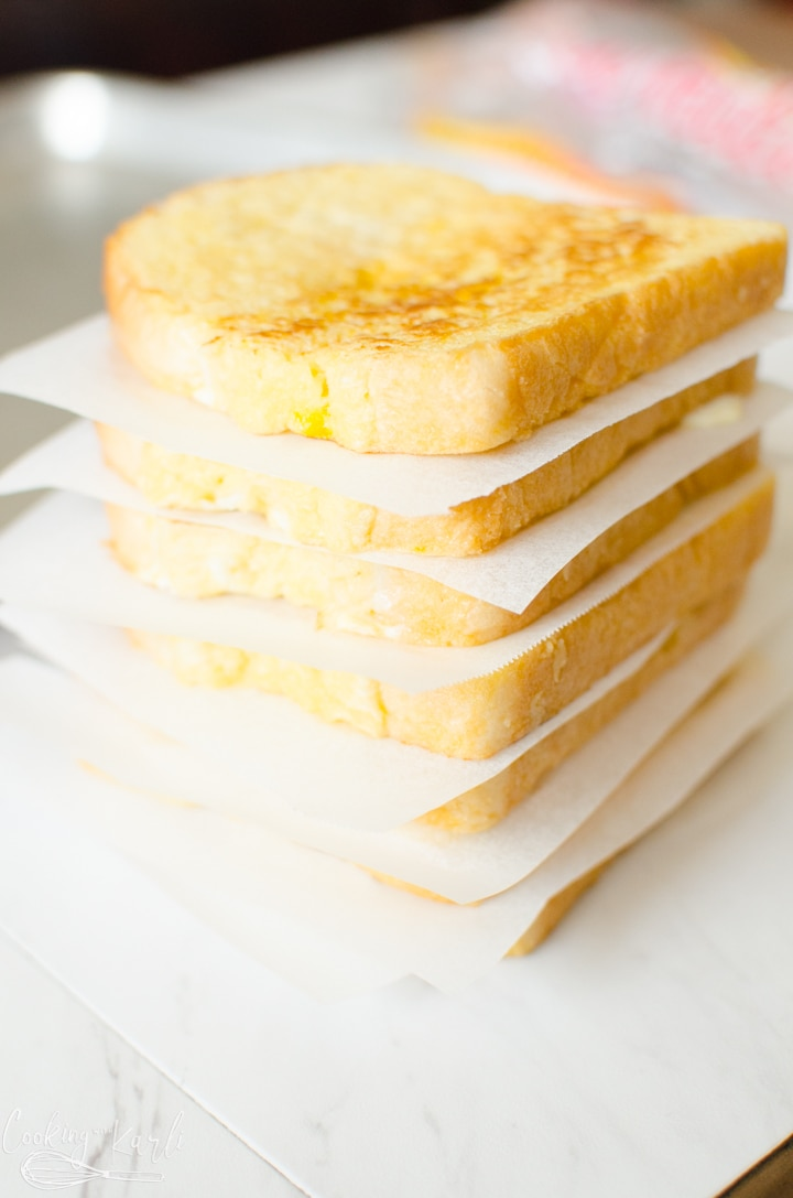cooled French toast with parchment paper squares in between each slice