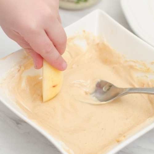 Peanut Butter Yogurt Apple Dip is Kid Cook friendly and good for a growing body too! Made from plain yogurt and powdered peanut butter, this dip is sure to make apples disappear fast!
