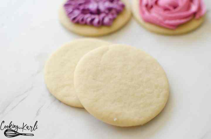 Perfect Sugar Cookie Recipe is really just that- PERFECT. These sugar cookies come together quickly with only 6 ingredients; butter, sugar, egg, vanilla, flour and baking soda. The cookies keep shape while baking, are soft and chewy, plus there is NO refrigeration! This Sugar Cookie recipe is PERFECTION!