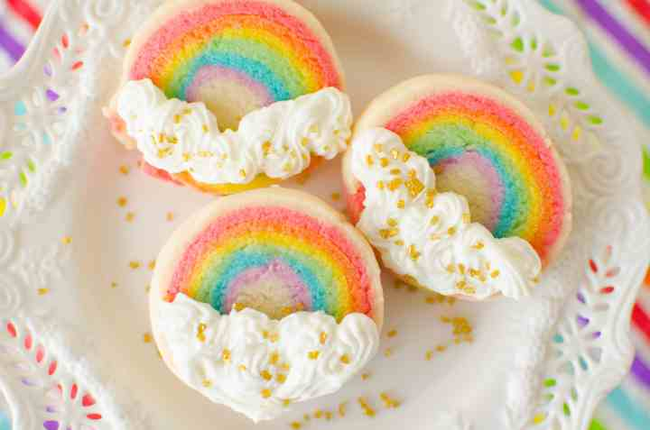 Slice 'n Bake Rainbow Sugar Cookies are made from a soft vanilla sugar cookie dough, rolled in layers, then sliced and baked. The cookies are finished off with vanilla butter cream clouds.