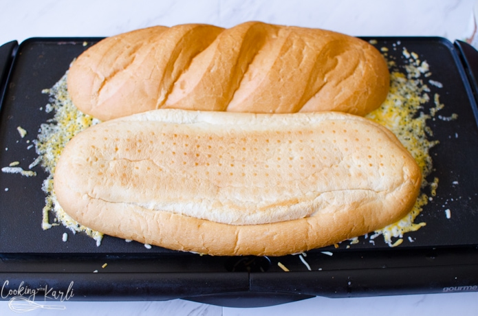 French bread toasting on a large griddle