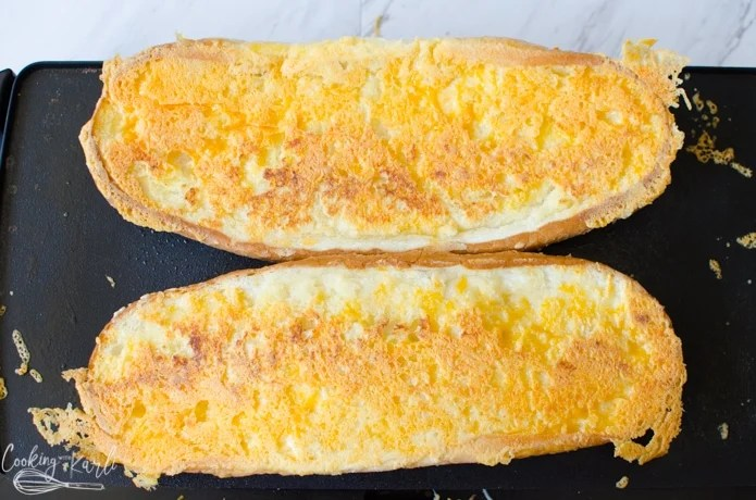 Finished crispy garlic cheese bread on the griddle.