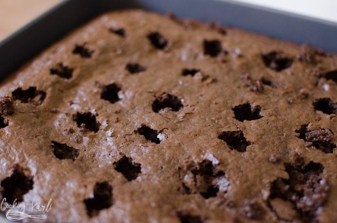 holes in the chocolate cake before finishing the oreo poke cake.