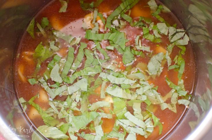 basil, crushed tomatoes and seasoning added to the pot