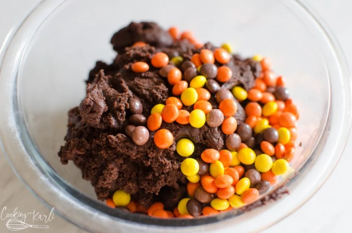mini Reese's pieces added to the chocolate cookie batter