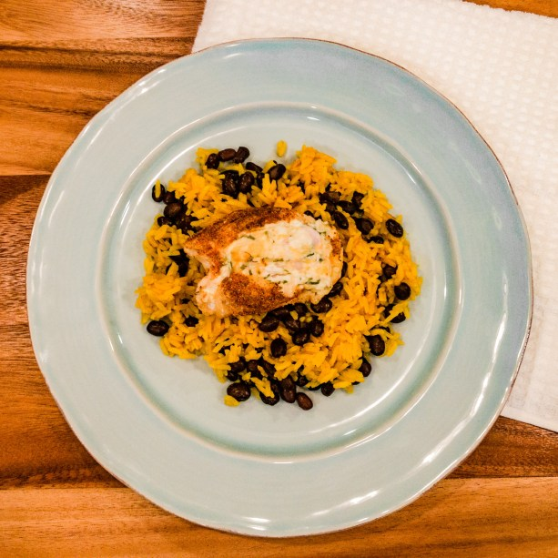 jalapeno cream cheese stuffed chicken, dry-rubbed with mexican spices, on a bed of yellow spanish rice and black beans
