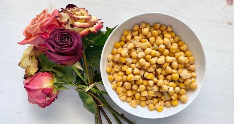 Bowl of homemade chickpeas with bouquet of roses