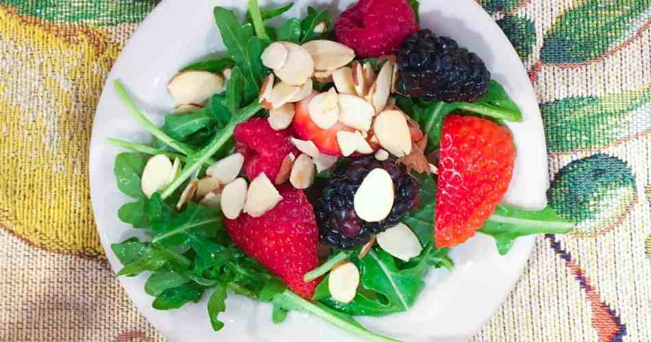 Baby Arugula Salad with Mixed Berries on small white plate