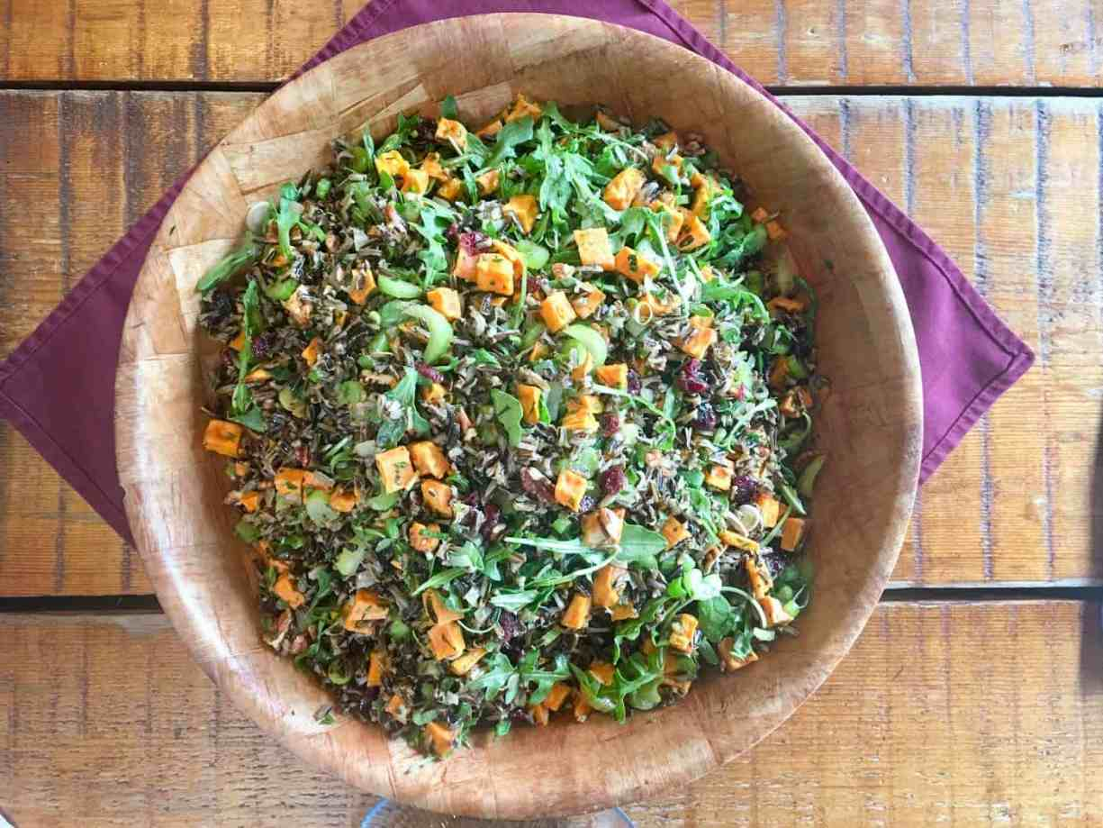wild rice pilaf with roasted vegetables in wooden bowl