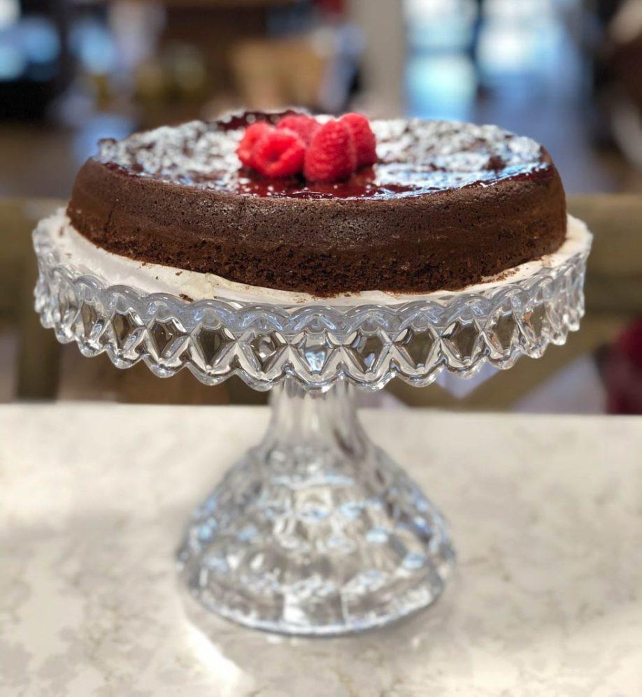 Dark Chocolate Olive Oil Cake on cake stand