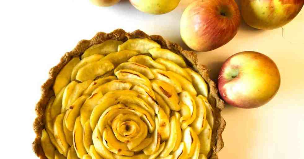 Gluten Free French Apple Tart with whole apples on the side