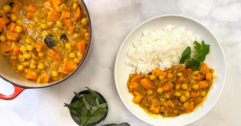 Indian Chickpea and Sweet Potato Curry bowl and cooking pot