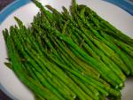 Roasted asparagus in blue and white serving plate