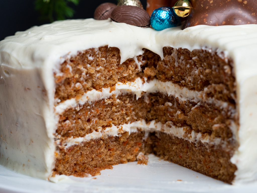 Three layered carrot cake with cream cheese frosting