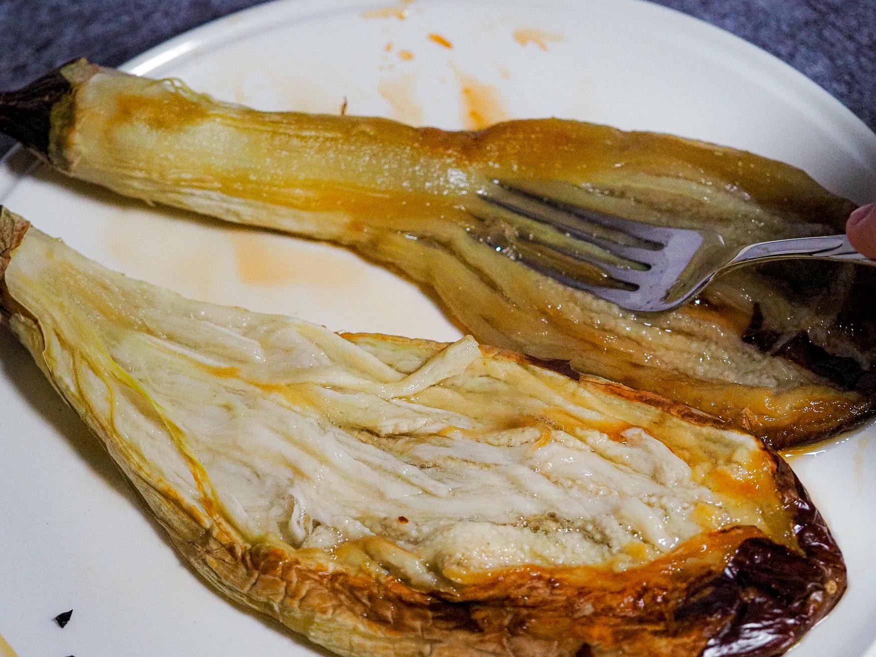 Peeled blackened Japanese eggplant on the plate.