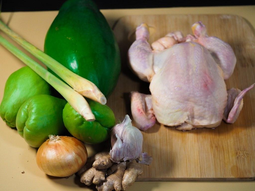 whole chicken, 3 medium chayote, 1 large green papaya, 2 lemongrass stem, 1 onion, garlic bulb and ginger