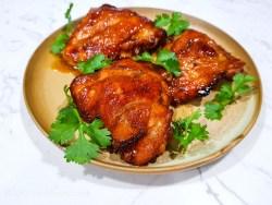grilled sriracha char siu chicken thighs garnished with cilantro