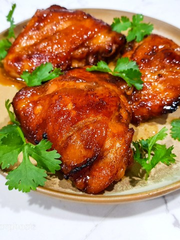 grilled sriracha char siu chicken thighs garnished with cilantro