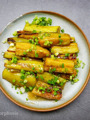 Japanese white miso eggplant garnished with chopped green onion