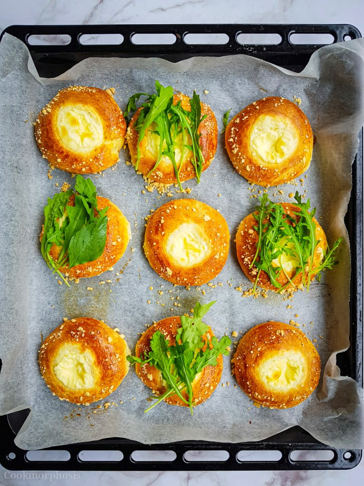Savory cream cheese kolaches topped with fresh arugula