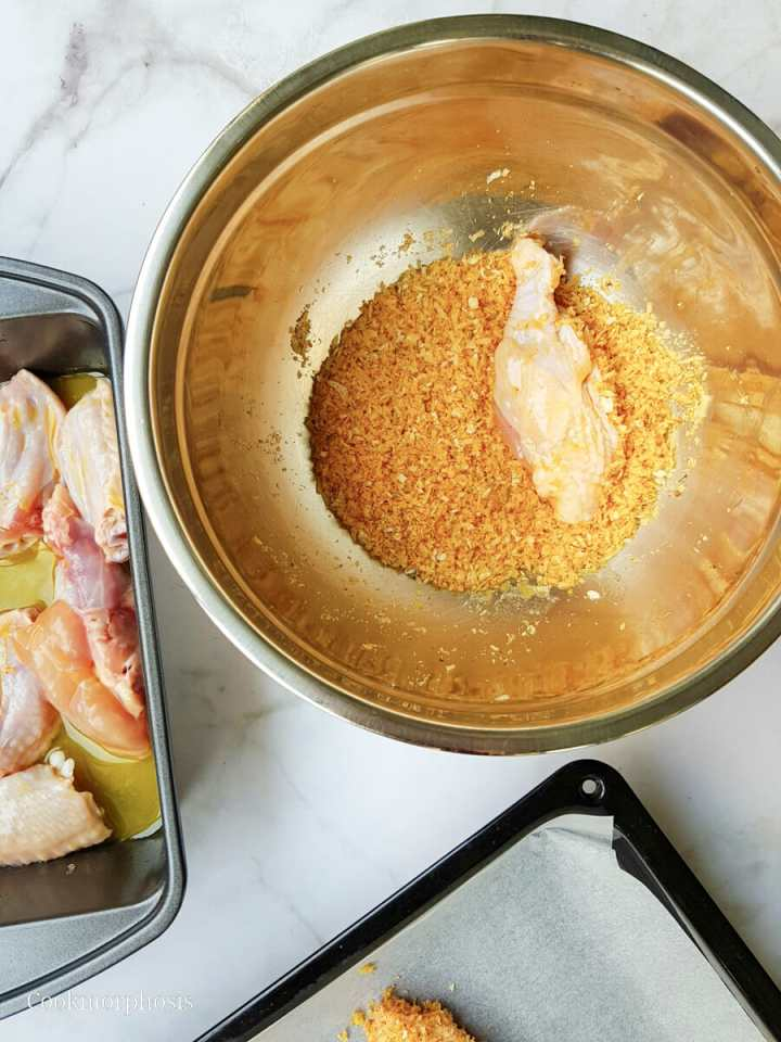 chicken drum dredge in parmesan, panko, and seasoning mixture