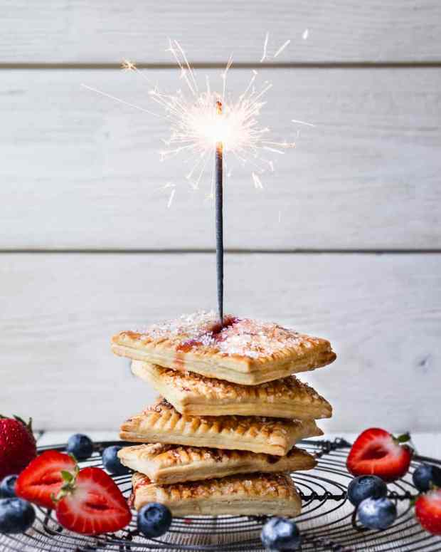 photo of sparkler in hand pies