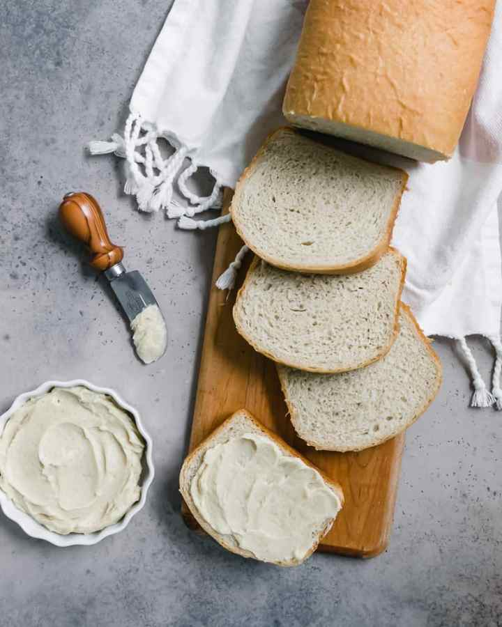 overhead of sliced bread with dish of honey butter