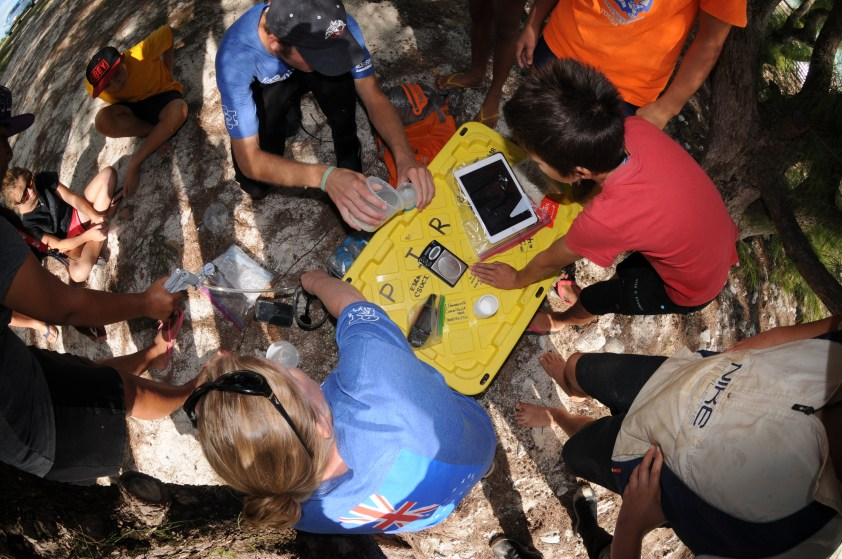 Araura College students learning how to search for and quantify microplastic particles in beach sand.
