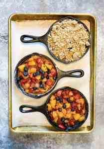 Adding oatmeal crisp topping to Mixed Fruit and Basil Crisp