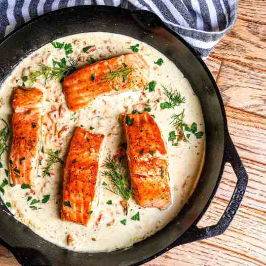 Cast iron skillet with Seared Salmon in Lemon Dill Cream Sauce