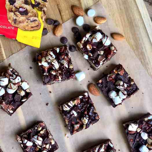 Rocky Road Chocolate Shortbread Bars with spilled extra almonds and marshmallows