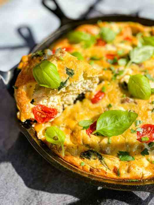 Italian Frittata being sliced in a cast iron pan.