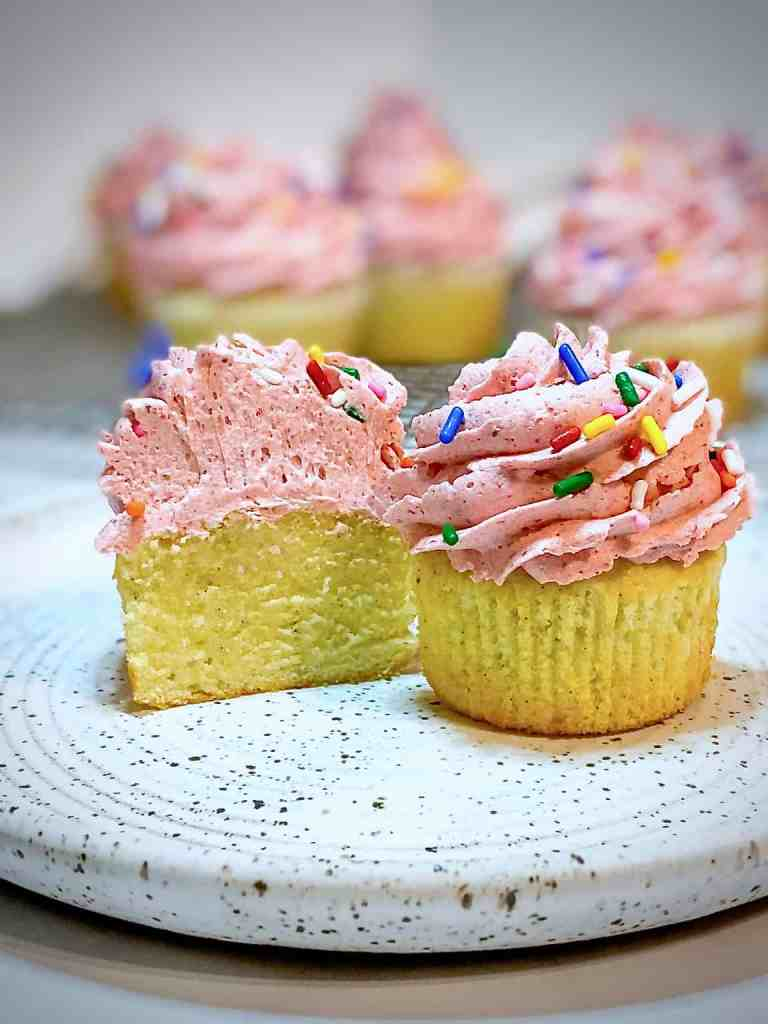 Cut view of Vanilla Cupcakes with Strawberry Buttercream
