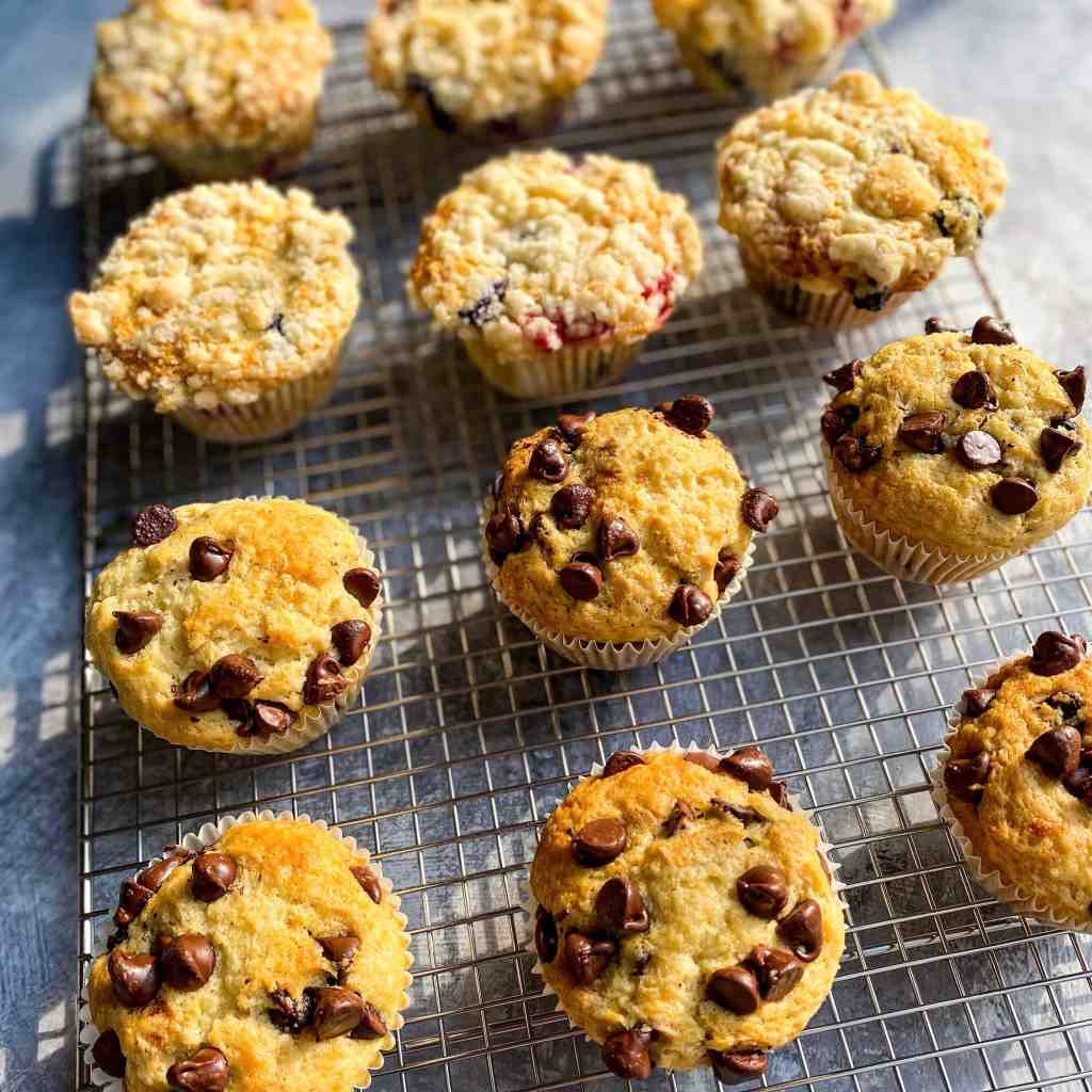 Blueberry Streusel and Chocolate Chip Muffins, cooling on a wire rack.