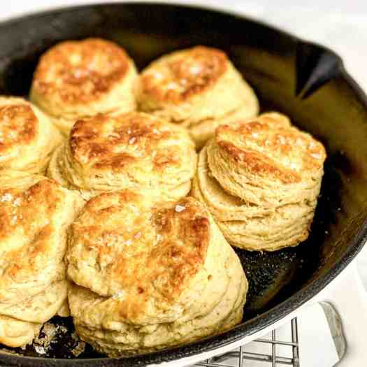 Cast iron pan filled with ultra-flaky buttermilk biscuits