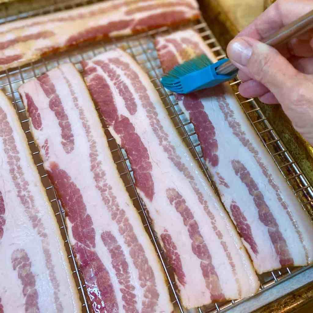 Brushing maple syrup on bacon