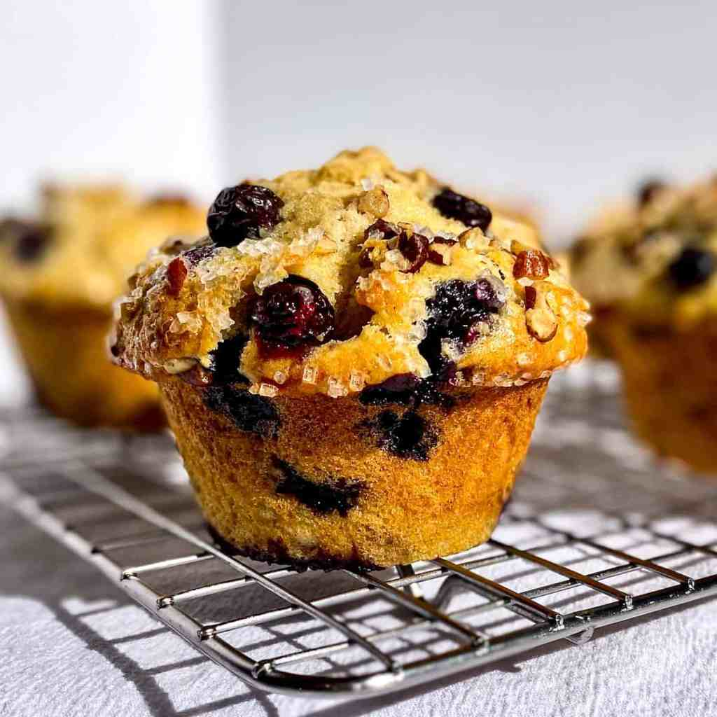 Blueberry Pecan Buttermilk Muffin on a wire rack