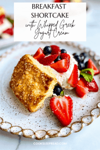 Pinterest Image of Breakfast Shortcake with a dollop of whipped Greek yogurt cream, fresh fruit, and a sprig of mint