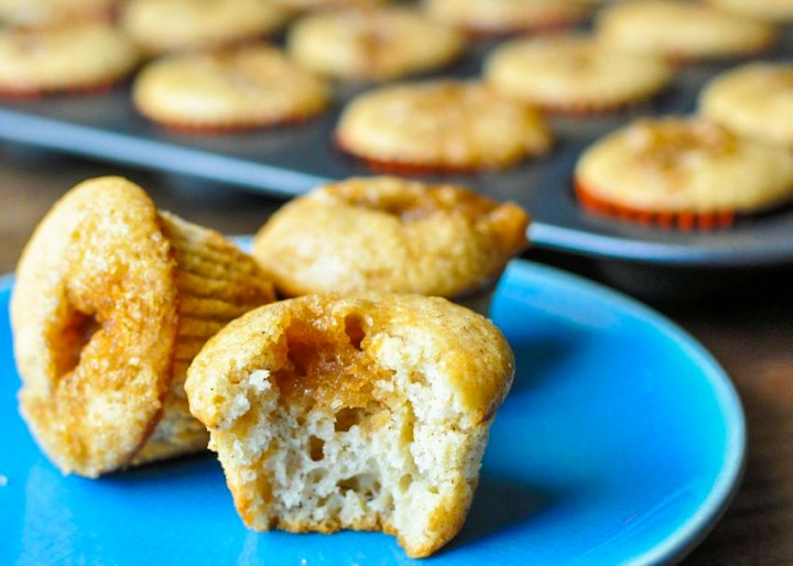 3 apple spice mini muffins on a blue plate