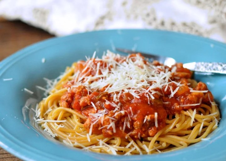 Spiced Up Ground Turkey Spaghetti Sauce in a blue bowl