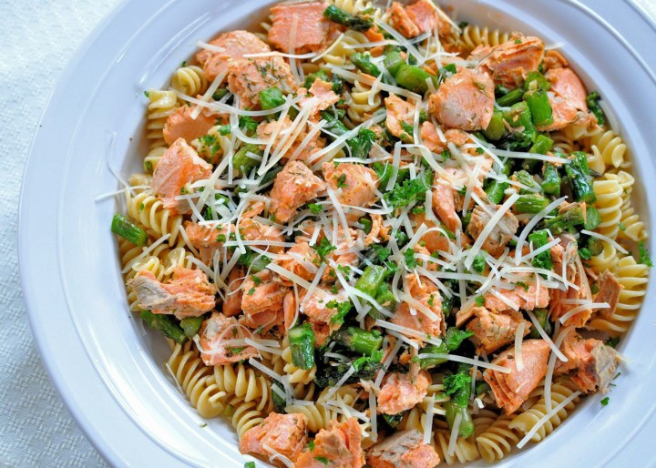 Overhead shot of Salmon with Pasta and Asparagus in a white bowl