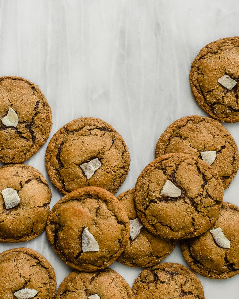 chewy ginger molasses cookies on marble