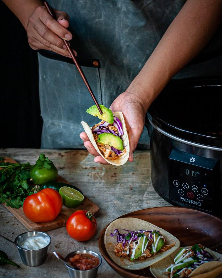 assembling chicken taco